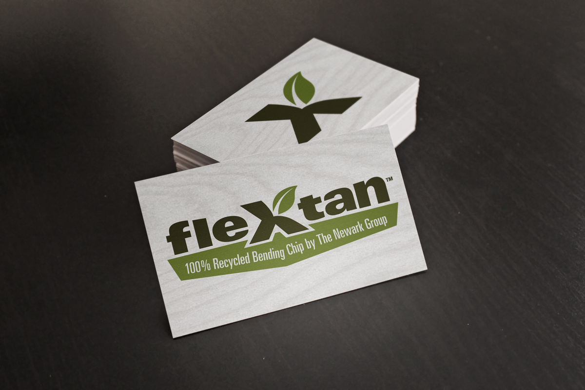 Flextan's logo design as displayed on a business card.
